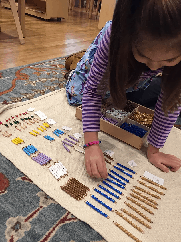Child with counting beads