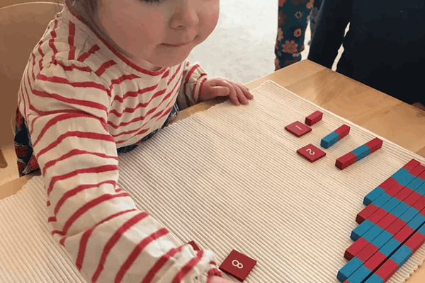 Child learning with number tiles